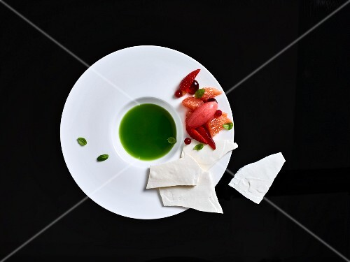 Sweet basil soup with fruit salad and meringue