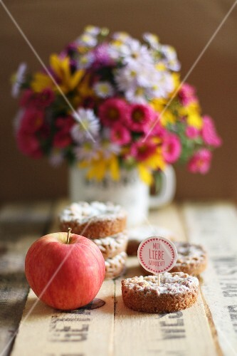 Small apple cakes with a decorative topper