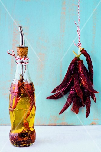 Home-made pizza chilli oil in a recycled Cola bottle