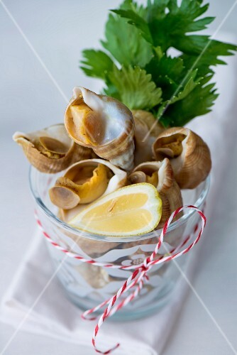 Whelks in a glass with lemon and parsley