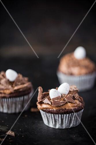 Chocolate cupcakes with sugar eggs