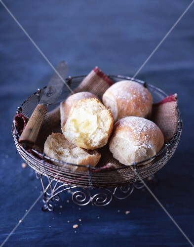Bread rolls with butter in a bread basket