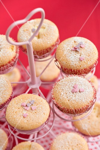 Cupcakes decorated with sugar hearts in a cupcake stand