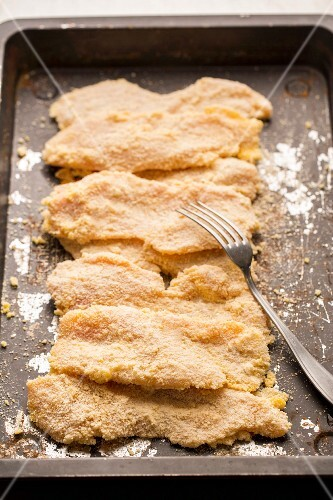 Chicken escalopes in breadcrumbs ready to be fried