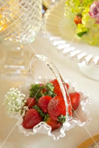 Fresh strawberries in an elegant glass basket