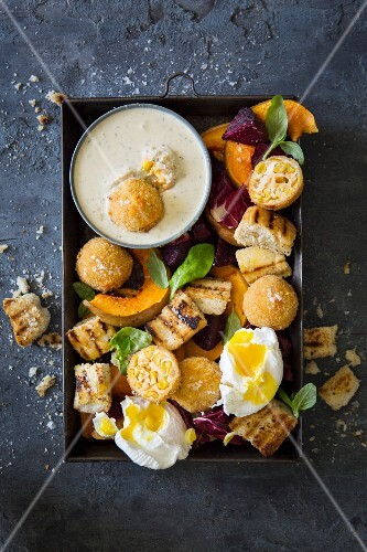 Panzanella with sweetcorn and ricotta fritters and a blue cheese dressing