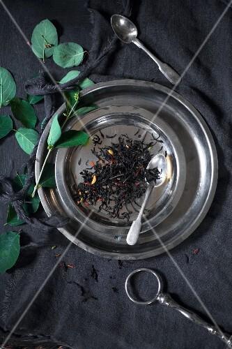 Tea leaves on metal plate