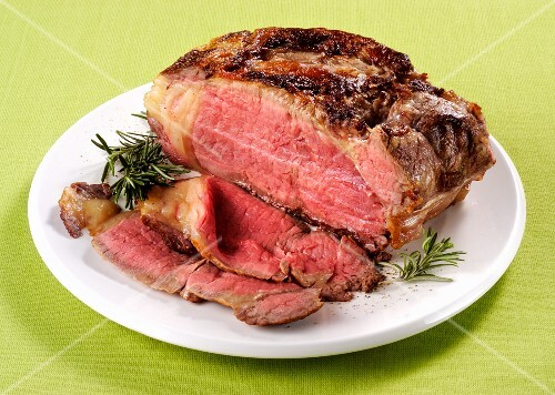 Sliced roast beef with rosemary
