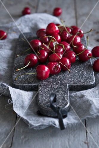 Cherries on a chopping board