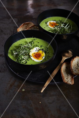 Pea soup with soft-boiled egg, cress and black sesame seeds