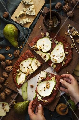 Smoked paprika focaccia with gorgonzola, pears, walnuts and honey