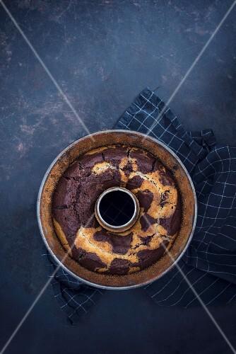 Vegan marble cake in a ring-shaped baking tin