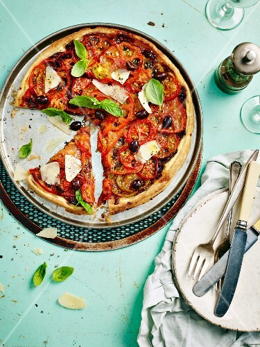 Tomato tart with olives, parmesan and basil