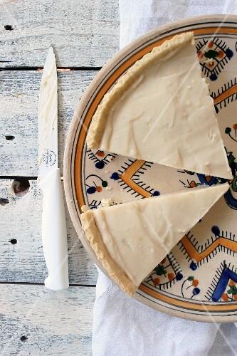 Vanilla cream tart on a patterned plate