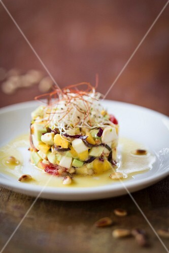 Mango and mozzarella tartare with shoots in an orange vinaigrette