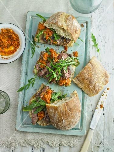 Pepper steak sandwich with blush tomato pesto and roasted garlic mayo