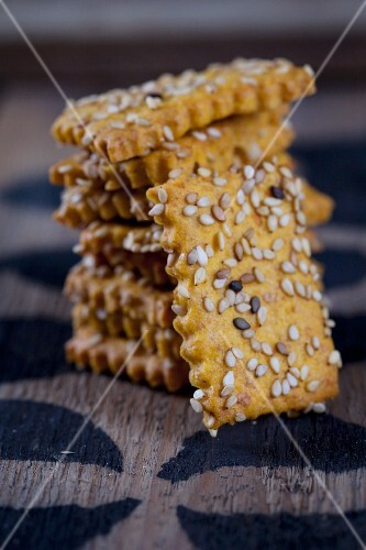 A stack of sweet potato crackers with sesame seeds
