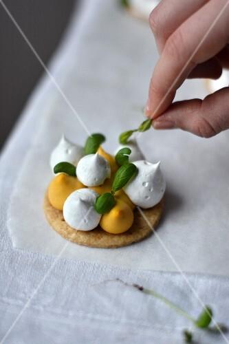 Lemon meringue tarts with basil