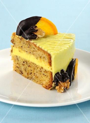 A piece of walnut cake with candied oranges
