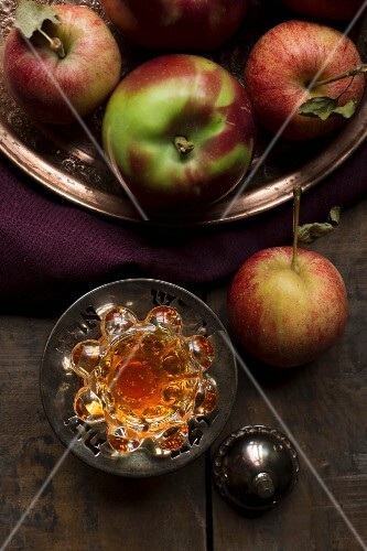 Apple juice and apples in a vintage setting