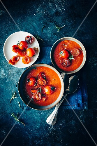 Tomato and red onionsoup, fresh rosemary leafs
