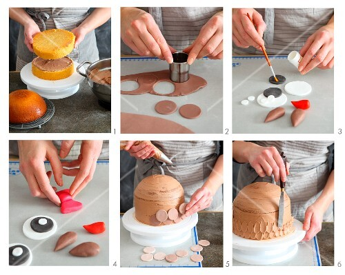 Owl-shaped chocolate cake being decorated