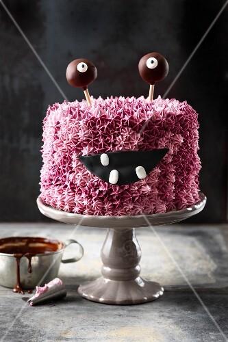 A pink 'Monster Alarm' buttercream cake