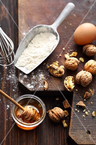 Ingredients for a nut cake: flour, honey, eggs and walnuts