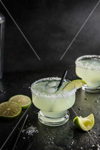 Margarita cocktail with salted rim glass, lime and tequilla