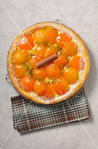 An apricot dish with pistachios (top view)