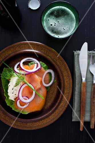 Smoked salmon with cheese cream and onions