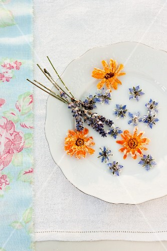 Sugared flowers on a vintage plate