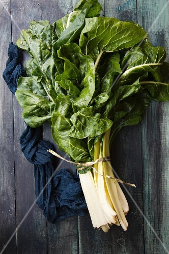 Fresh chard on a wooden surface