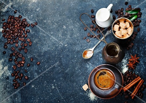 Top view of Espresso coffee, milk and sugar on black marble table