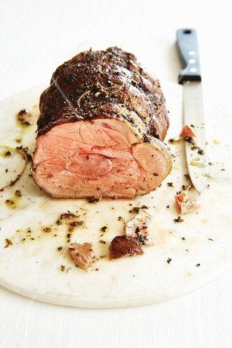 Pink roast lamb cooked at a low temperature