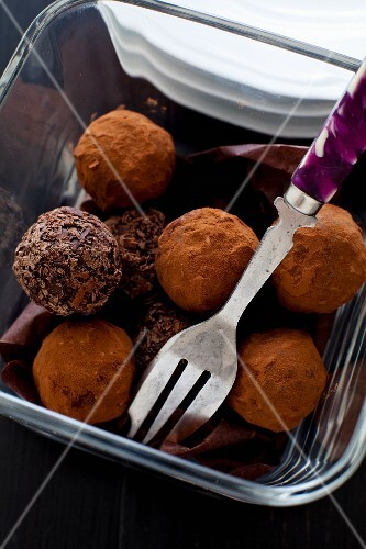 Chocolate truffles in a glass bowl with a fork