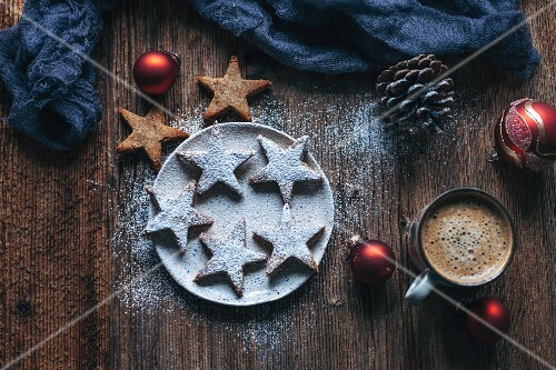 Almonds cinnamon Christmas cookies on a plate and rustic wooden table