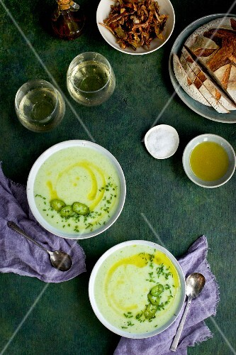 Cream of Potato Chive Soup with Chili Oil and Roasted Jalapeno. Served with bread and white wine