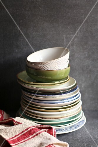 Stack of colorful plates on dark background