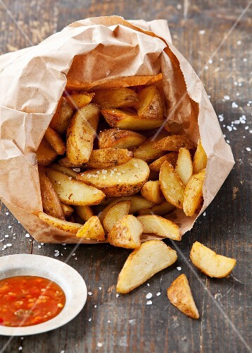 Fried potato country-style in paper bag
