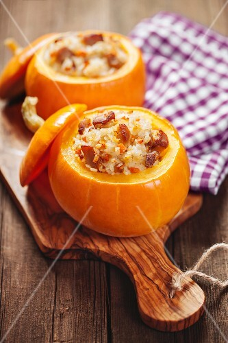 Roasted little pumpkins stuffed with chicken meat, vegetables and rice