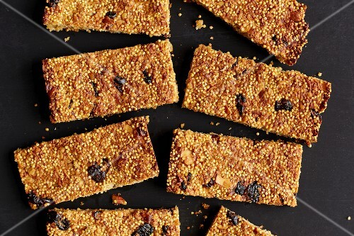 Millet bars with cranberries, banana and chopped almonds