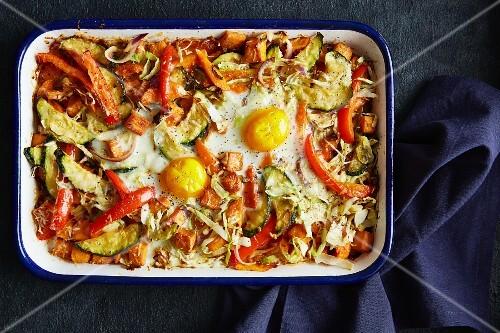 Wild vegetable bake with fried eggs (vegetarian)