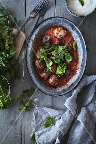 Harissa meatballs with coriander garnish