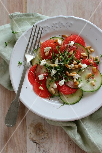 Cucumber and melon carpaccio with pine nuts