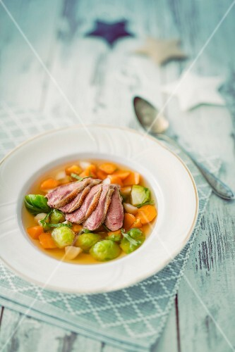 Poultry consomme with carrots and brussels sprouts (Christmas)