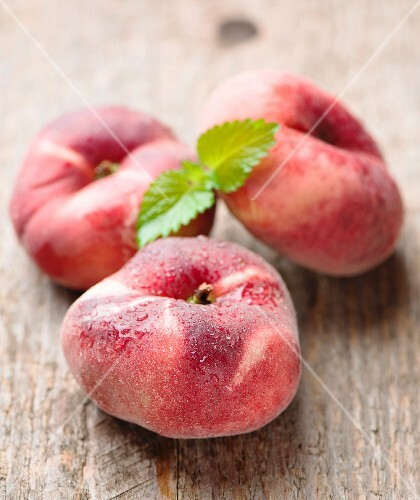 Ripe juicy chinese flat peaches (also called Saturn peaches)