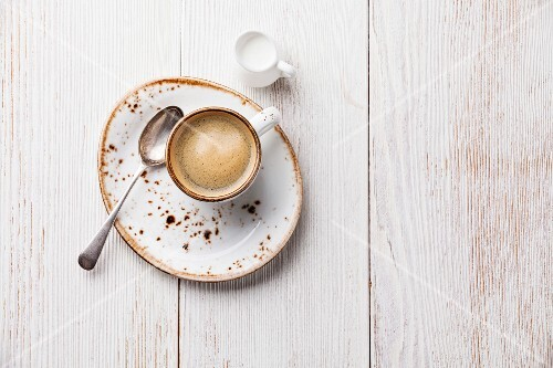 Coffee cup on white wooden background