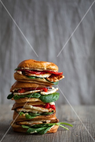 A stack of halloumi, houmous and red pepper brioche burger