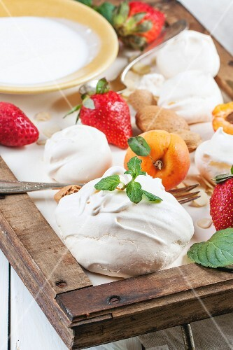 Ingredients for dessert Eton mess: Homemade meringue with apricots, strawberries, almonds and cream